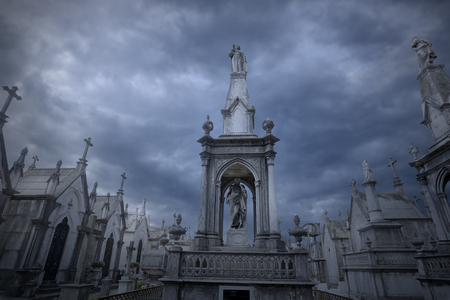 Old eurpopean cemetery against dramatic cloudy sky Stock Photo