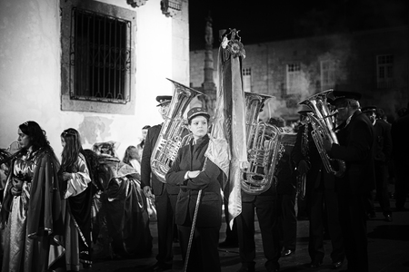 Braga, Portugal - April 1, 2010: Elements of a brass band preparing for the religious procession of the Ecce Homo during Holy Week