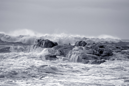 Rough sea on the northern portuguese rocky coast. Used infrared filter. Toned blue. Stock Photo