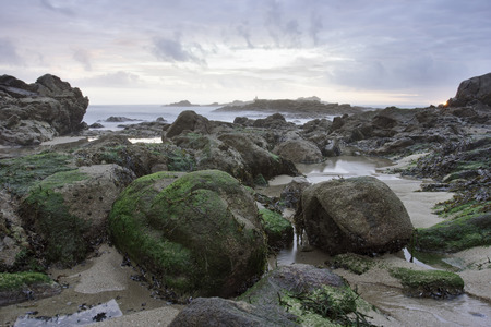 Northern portuguese rocky beach during low tide at sunset. Stock Photo