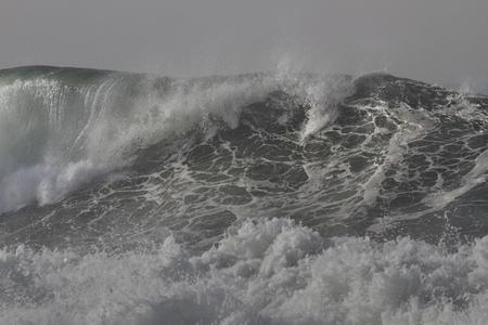 Big breaking sea wave closeup