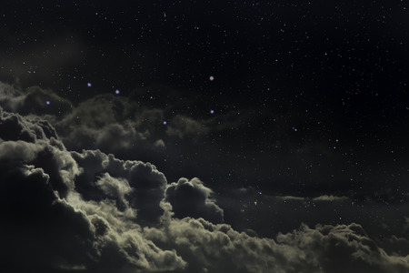 Starry night sky with clouds Stock Photo