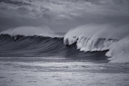 Long stormy waves approaching the Portuguese coast. Toned blue. Фото со стока