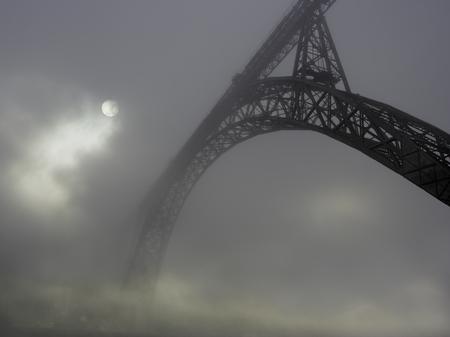 Oporto old iron bridge in the fog. Banco de Imagens