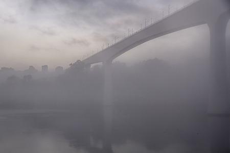 Douro mriver bridge in a misty dawn, Porto, Portugal