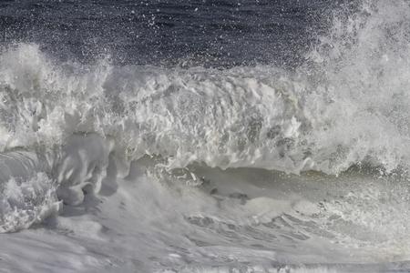 Foam breaking sea stormy wave on the Portuguese coast