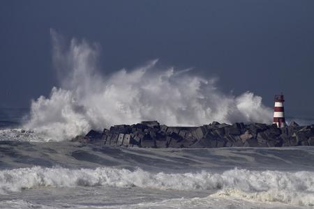 Stormy waves splash. Povoa de Varzim and Vila do Conde harbor entry, north of Portugal.