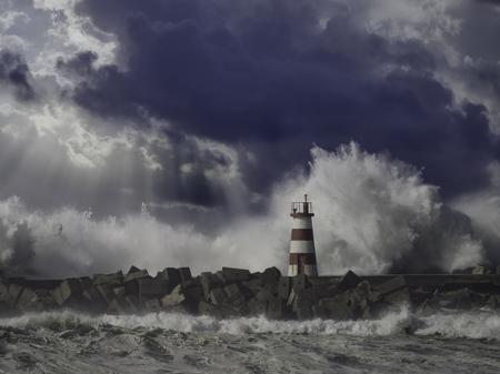 Rough sea. Beacon and pier of Povoa de Varzim harbor entry. Northern portuguese coast. Enhanced sky.