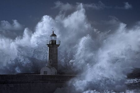 Big stormy sea wave splash over old Oporto lighthouse. Douro river mouth. Infrared.