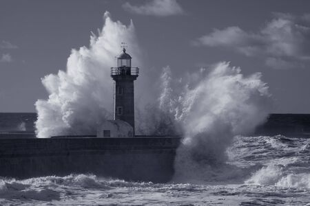 Stormy seascape. Old lighthouse of Douro river mouth, Porto, Portugal. Used infrared filter. Toned blue.
