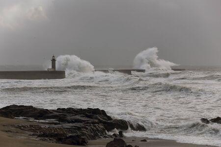 Stormy seascape. Douro river mouth, Porto, Portugal.