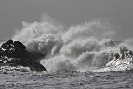 Rough sea wave splash. Northern portuguese rocky coast