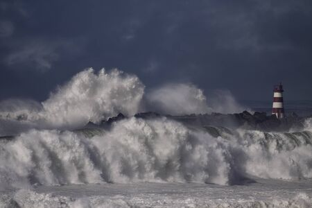Crashing waves over harbor entry. North of Portugal. Stock fotó
