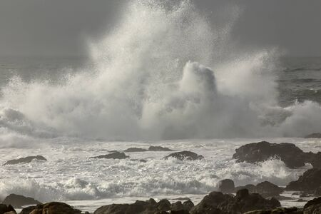 Wave splash in a rocky beach from the north of Portugal. Reklamní fotografie