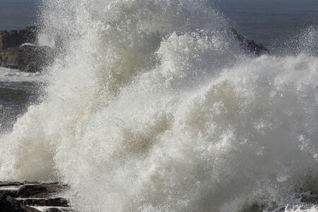 Big wave splash closeup in a stormy but sunny day. Stock fotó