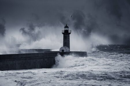 Dramatic storm at the Douro river mouth, Oporto. Enhanced sky. Toned blue.