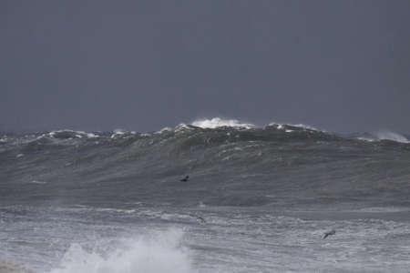 Big stormy Atlantic sea wave against a dark rainy sky