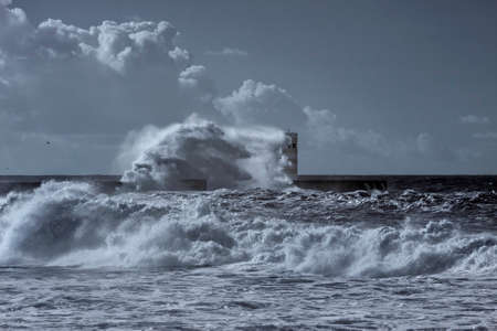 Storm at the Douro river mouth. Used infrared filter. Toned blue.