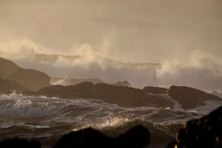 Stormy sea waves at sunset. Northern portuguese rocky coast. Reklamní fotografie