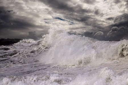 Big breaking stormy wave. Enhanced sky.