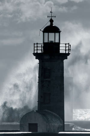 Dark and dramatic storm. Lighthouses of Douro river mouth.