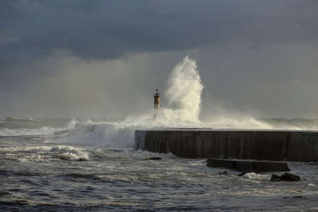 Ave river mouth, Vila do Conde, north of Portugal, during storm. End of the day light.