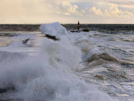 Ave river mouth in a stormy evening at sea