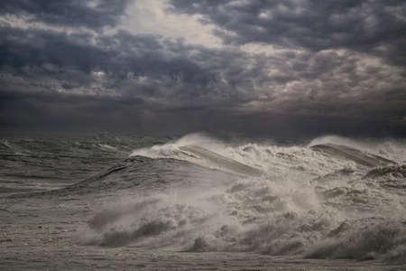 Stormy seascape with cloudy dark sky. Enhanced sky. Stock fotó