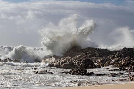 Big wave splash in a northern portuguese rocky beach
