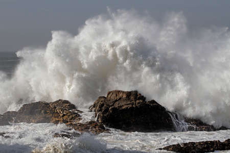 Big stormy wave splash. Northern portuguese rocky coast.