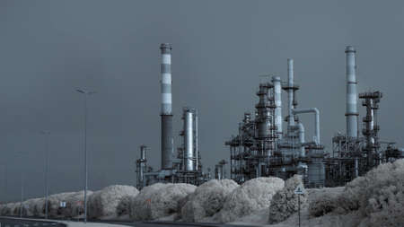 Part of a big oil refinery by the road. Used infrared filter. Toned blue.