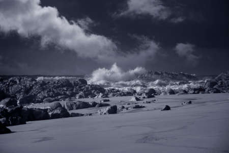 Wide view of an empty beach during winter. North of Portugal. Used infrared filter.