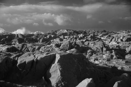 Rocky beach during winter. Used infrared filter. Archivio Fotografico