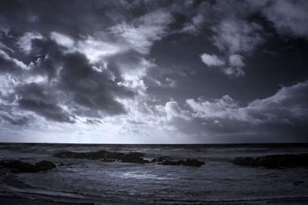 Infrared seascape with a dramatic cloudy sky Archivio Fotografico
