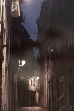 Foggy narrow old street from Oporto at dawn. Archivio Fotografico