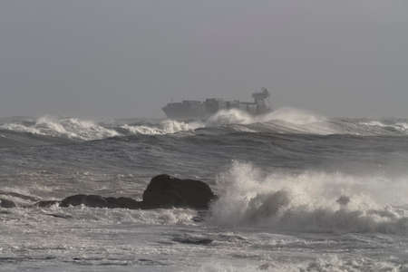 Container ship crossing the Portuguese coast on a stormy day