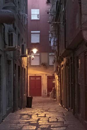 Old port grunge alley at dawn Archivio Fotografico