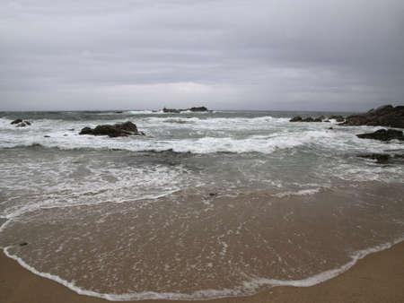 Beautiful northern portuguese beach against dark sky. Archivio Fotografico