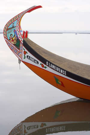 Aveiro, Portugal - July 30, 2006: Bow of a moliceiro (traditional algae-catching boat) from the Ria de Aveiro with its traditional naive painting, in this case erotic. Editorial