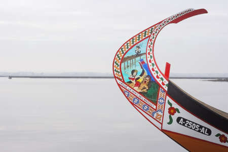 Aveiro, Portugal - July 30, 2006: Bow of a moliceiro (traditional algae-catching boat) from the Ria de Aveiro with its traditional naive painting, in this case erotic.