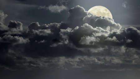 Cloudy full moon night panorama.