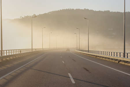Mountain viaduct in a foggy dawn