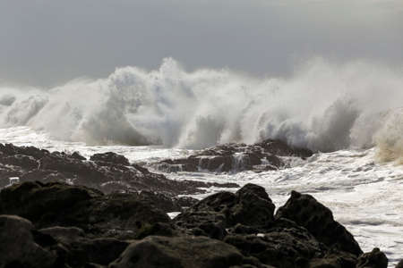 Big breaking wave. Northern Portuguese rocky coast.