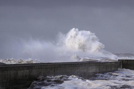 Dramatic seascape. Douro river mouith north piers during a sea storm. Archivio Fotografico