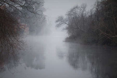 Foggy river at dawn. Ave river, north of Portugal