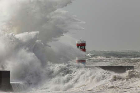 Big stormy wave splash. Douro river mouth new north pier, Porto, Portugal