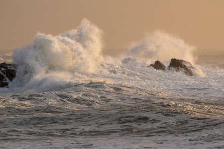 Waves splash at sunset. Northern portuguese rocky coast. Archivio Fotografico