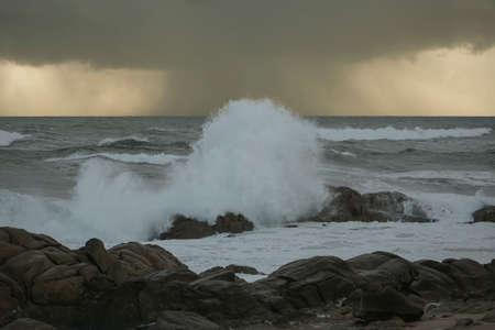 Rainy seascape before big storm at sunset.
