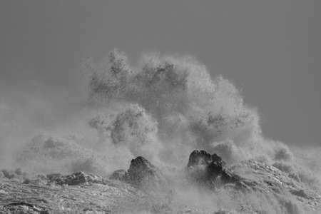 Rocks of the English north coast flooded by stormy big waves seeing splash Archivio Fotografico