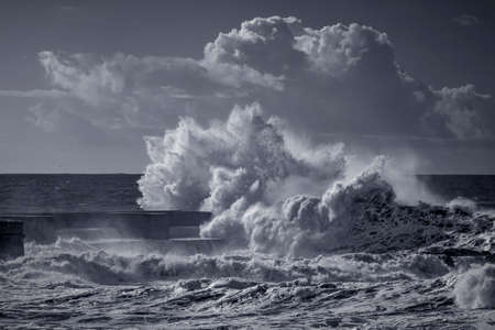 Stormy seascape. Douro river mouth north pier, Porto, Portugal. Used infrared filter. Toned blue.